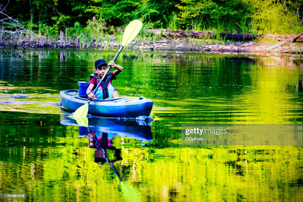 Young Hispanic boy kayaking : Stock Photo