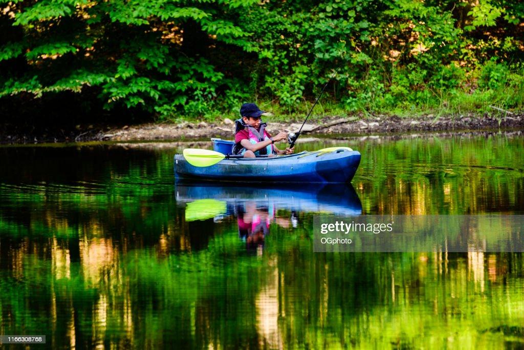Young Hispanic boy kayaking : Stock Photo