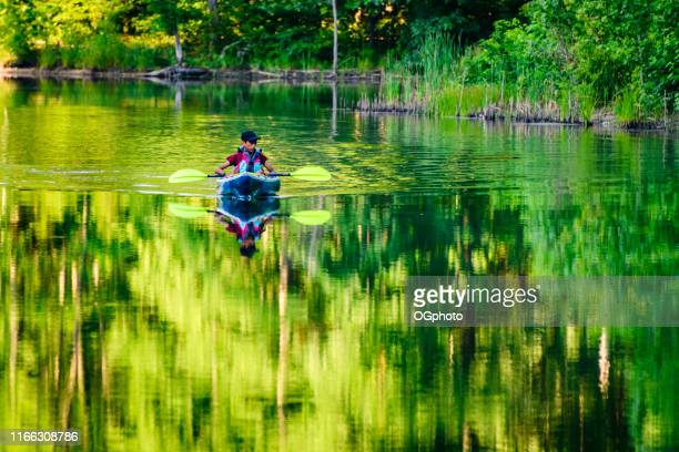 young hispanic boy kayaking - ogphoto stock pictures, royalty-free photos & images