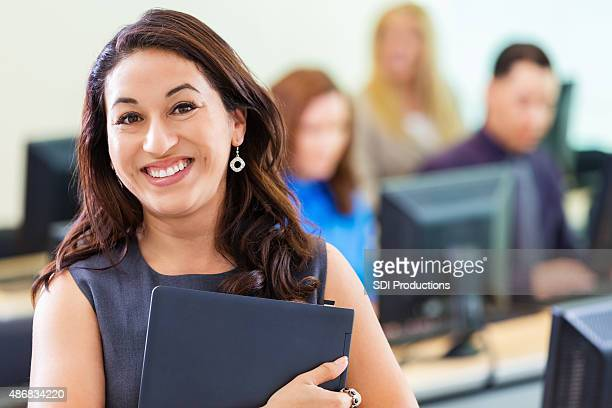Young Hispanic businesswoman taking job training computer course