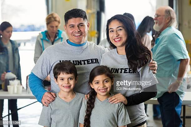 Young Hispanic family volunteering at food bank
