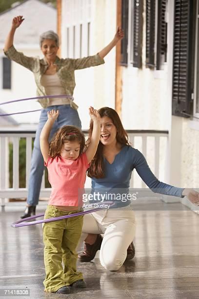 Young Hispanic girl playing with a hula hoop