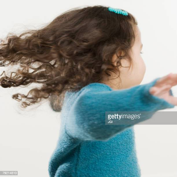 young hispanic girl spinning around - one girl only stock pictures, royalty-free photos & images