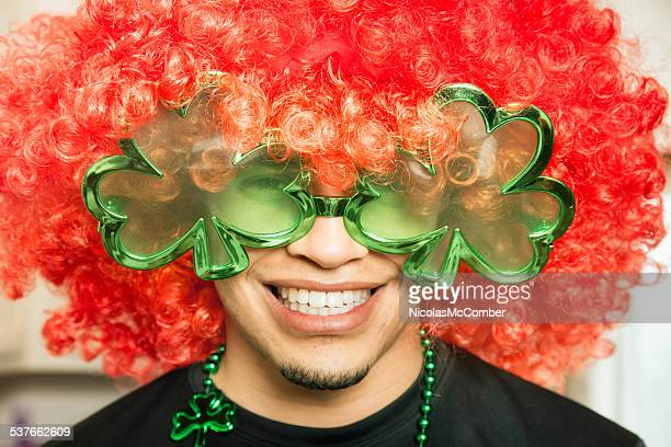 young hispanic guy ready for st. patrick's day party - leprechaun stock pictures, royalty-free photos & images
