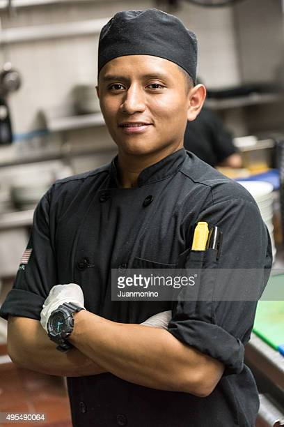 Young hispanic male kitchen worker