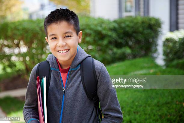Young hispanic student smiling