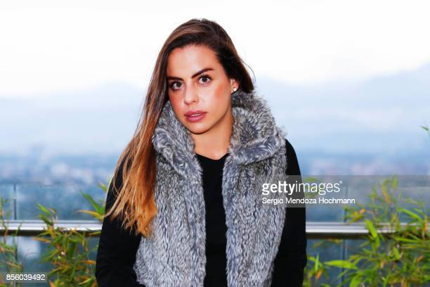 A Young Hispanic Woman Dresses In Fur Looking At Camera