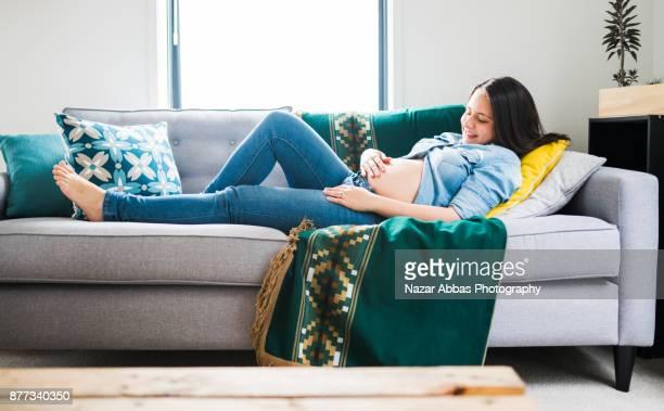 Young Hispanic woman lying on her back relaxing.