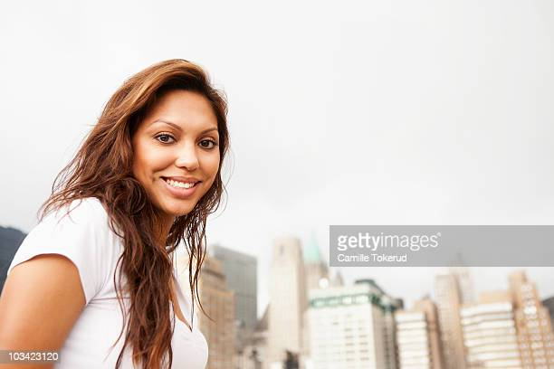 young hispanic woman smiling - newhealth stock photos and pictures