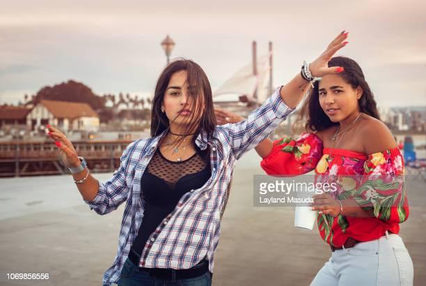 young hispanic women having fun at a pier - redondo beach california stock pictures, royalty-free photos & images