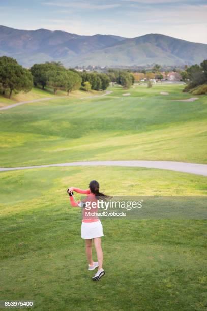 Young Hispanic Women Playing Golf