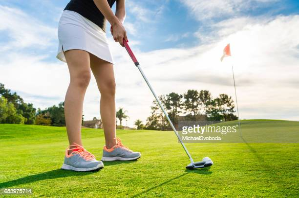 Young Hispanic Women Playing Golf