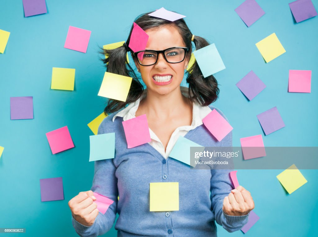 Young Hispanic Women Showing Emotional Expressions Coverd In Post-its : Stock Photo