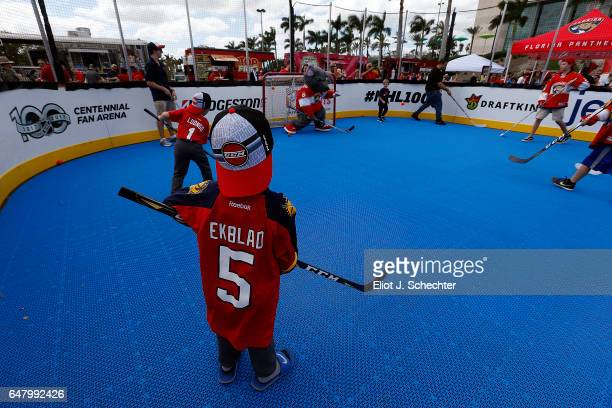 Young hockey fans play ball hockey outside the NHL Centennial Fan Arena Clear the Ice Zamboni® Experience, Stanley Cup® viewing at the BB&T Center on...