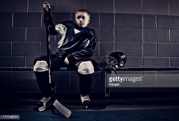 young hockey player - hockey stick stock pictures, royalty-free photos & images