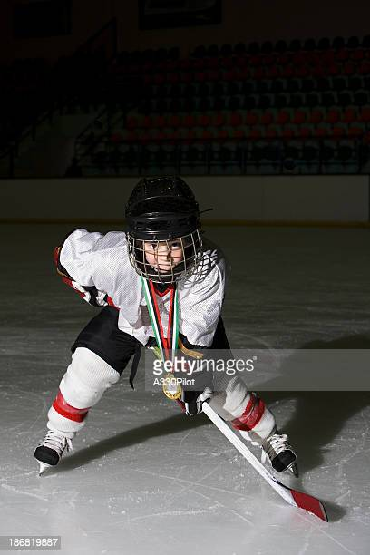 young hockey player - ice hockey rink stock pictures, royalty-free photos & images