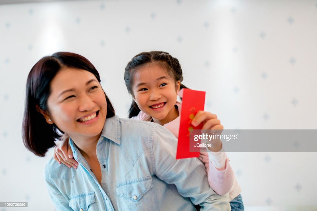 Young holding a red envelope for Chinese new year : Stock Photo