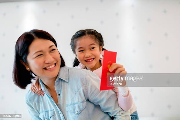 Young holding a red envelope for Chinese new year