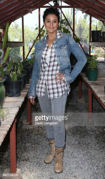 Young Hollywood Board Member/actress Emmanuelle Chriqui visits Carson Senor High School as part of Nature Works Everywhere Gardens on May 21 2014 in...