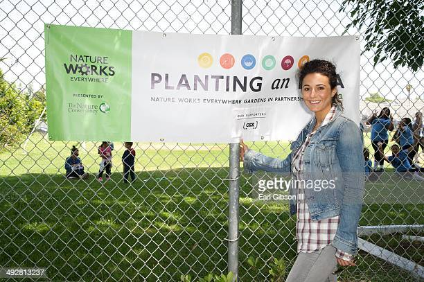 Young Hollywood Board Member/Actress Emmanuelle Chriqui visits Carson High School as part of Nature Works Everywhere Gardens on May 21, 2014 in...