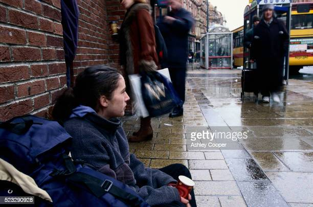 Young Homeless Woman Begging on Sidewalk in Leeds