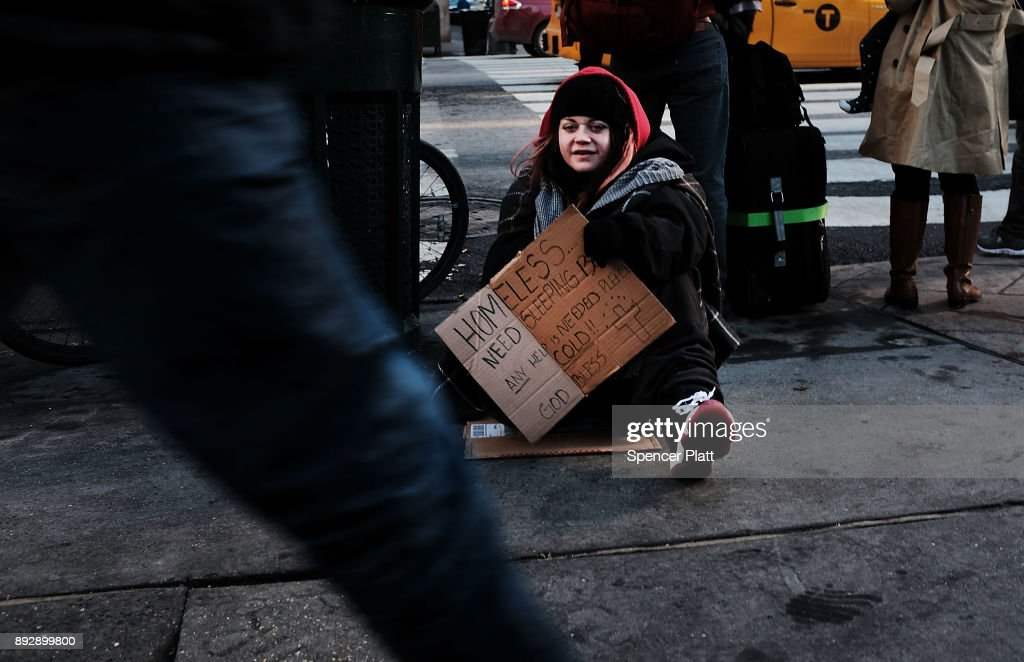A young homeless woman panhandles on the streets of Manhattan on December 14, 2017 in New York City. According to a new report released by the U.S. Department of Housing and Urban Development New York City's homeless population expanded by about 4 percent in 2017 as the number of homeless people nationwide grew to about 553,000.