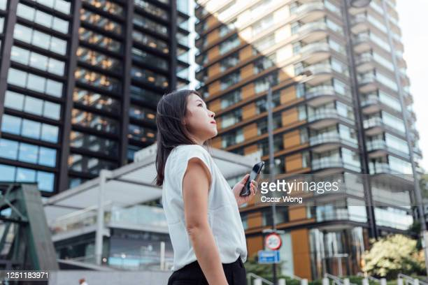 young homeowner panning for investment - asian and indian ethnicities stock pictures, royalty-free photos & images