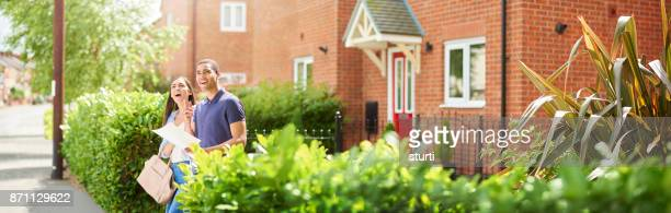 young househunting couple - moving house stock photos and pictures
