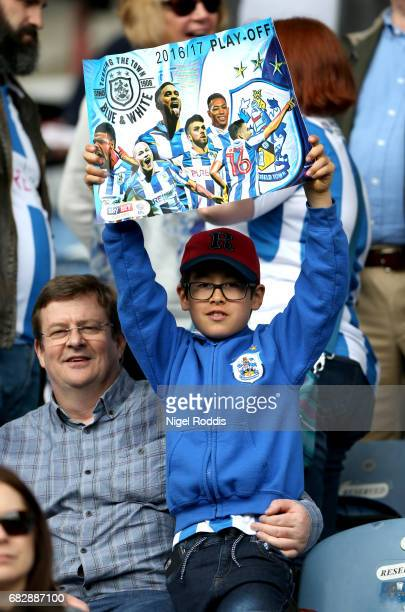 A young Huddersield Town fan holds up a poster prior to the Sky Bet Championship Play Off Semi Final 1st leg match between Huddersfield Town and...