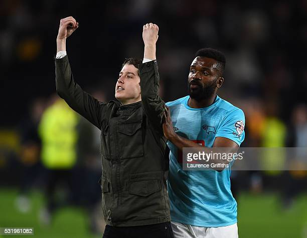 A young Hull City fan finds himself in the way of Darren Bent of Derby County during the Sky Bet Championship Play Off semi final second leg match...