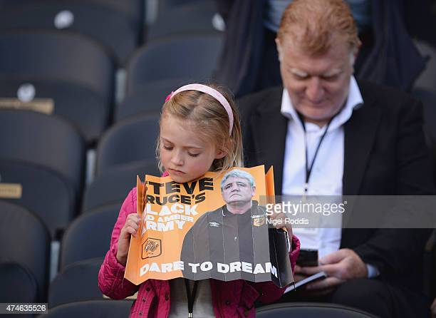 A young Hull City fan prays during the Barclays Premier League match between Hull City and Manchester United at KC Stadium on May 24 2015 in Hull...