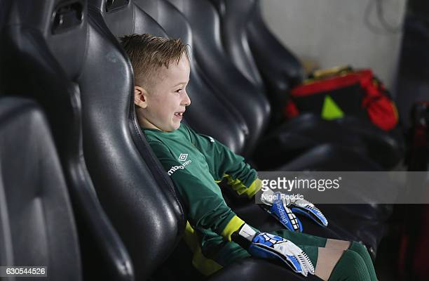 A young Hull fan sits in the dug out prior to the Premier League match between Hull City and Manchester City at KCOM Stadium on December 26 2016 in...