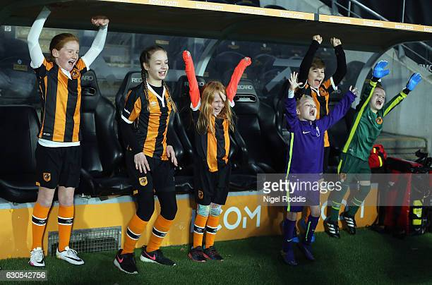 Young Hull fans cheer from the dug out prior to the Premier League match between Hull City and Manchester City at KCOM Stadium on December 26 2016 in...
