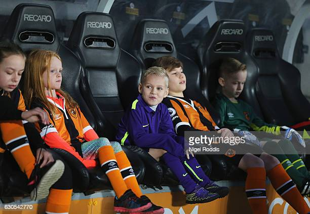 Young Hull fans sit in the dug out prior to the Premier League match between Hull City and Manchester City at KCOM Stadium on December 26 2016 in...