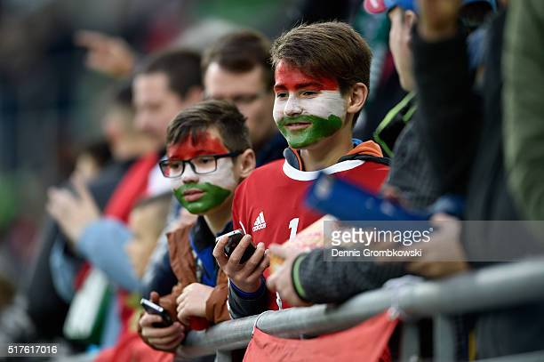 Young Hungary supporters watch players warm up prior to kickoff during the International Friendly match between Hungary and Croatia at Groupama Arena...