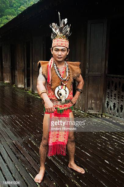 Young Iban tribal dressed up as Iban Chief in traditional costume at Sarawak Cultural Village near Kuching.