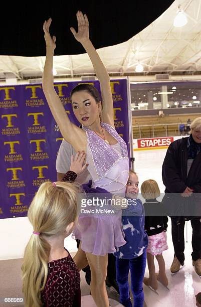 Young ice skaters examine a Michelle Kwan wax figure July 11 2000 in Los Angeles CA The wax replica of the threetime world champion and Olympic...