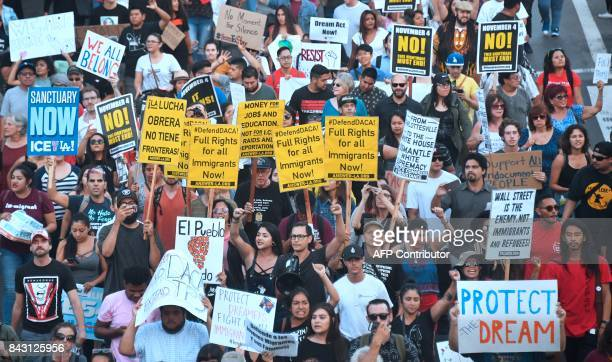 Young immigrants activists and supporters of the DACA program march through downtown Los Angeles California on September 5 2017 after the Trump...