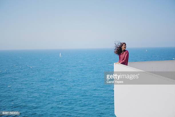young in front of the sea.atlantic ocean.copy space - overcoat stock pictures, royalty-free photos & images