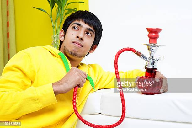 Young Indian Adult with a Hookah