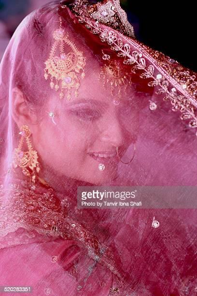 a young indian bride in her wedding day - bangladeshi bride stock photos and pictures
