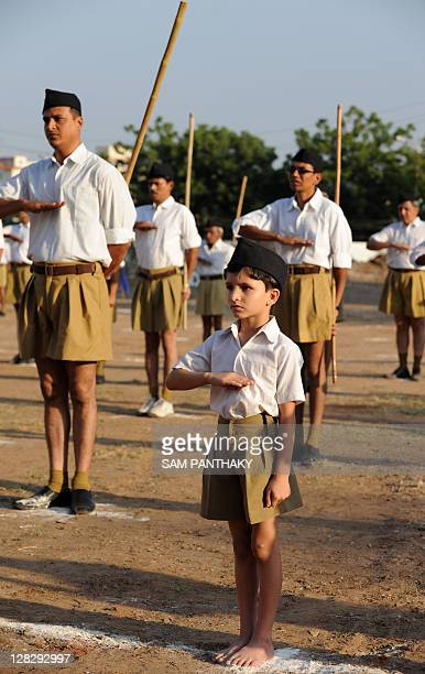 A young Indian child along with other members of the Rashtriya Swayamsevak Sangh National Volunteers Organisation participates in a drill on the...