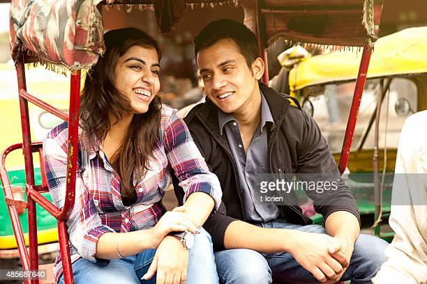 young indian couple in rickshaw . - rickshaw stock pictures, royalty-free photos & images