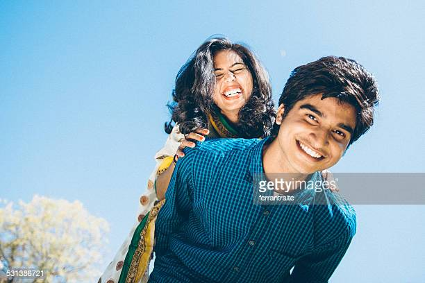 young indian couple piggyback - indian culture stock pictures, royalty-free photos & images