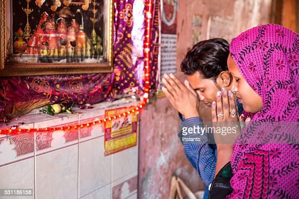 young indian couple praying - hinduism bildbanksfoton och bilder