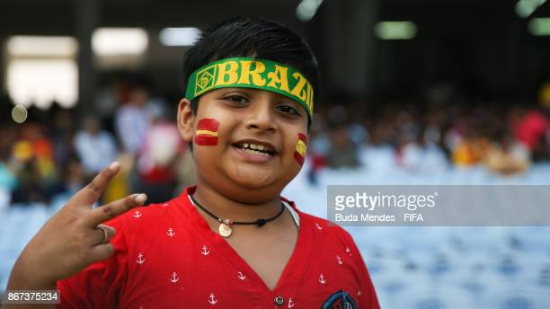 A young indian fan of Brazil smiles prior the FIFA U17 World Cup India 2017 3rd Place match between Brazil and Mali at Vivekananda Yuba Bharati...