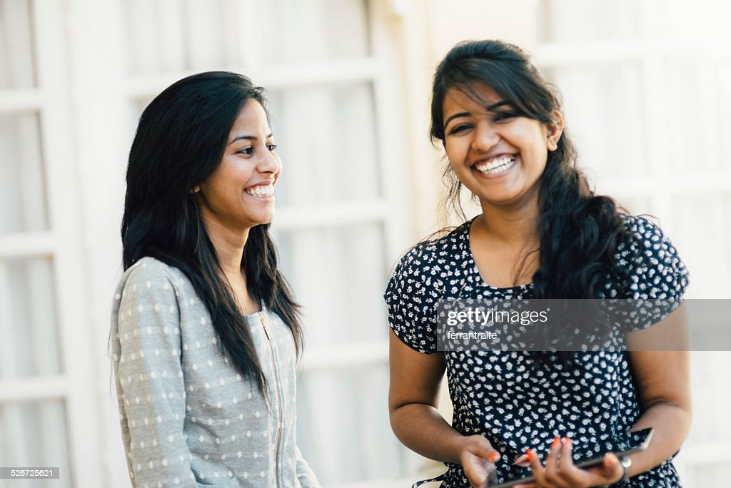 Young Indian Female Friends Using Digital Tablet : Stock Photo