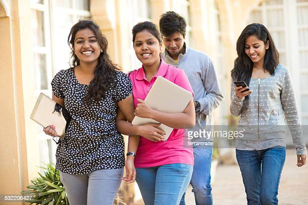 young indian female students at university - indian college girls stock photos and pictures