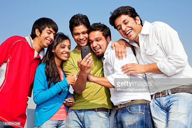 Young Indian Friends People reading Sharing SMS Joke Cell Phone