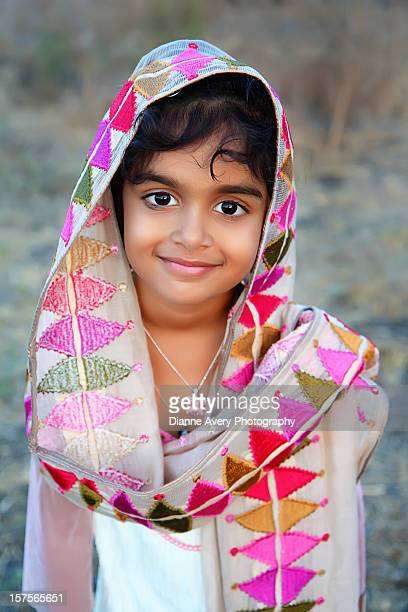 Young Indian girl draped in pink scarf